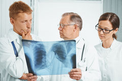 Doctors examine x-ray image in hospital Stock Photography