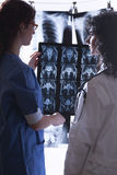 Doctors examine x-rays Stock Photography