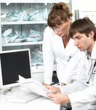 Doctors examining chart Royalty Free Stock Photo