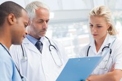 Doctors examining a file Royalty Free Stock Image