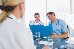 Doctors examining folders Royalty Free Stock Photo