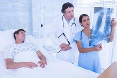 Doctors examining patients xray Royalty Free Stock Image