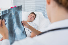 Doctors examining patients xray. In hospital room royalty free stock image