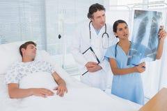 Doctors examining patients xray Stock Photo