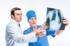 Doctors examining x-ray image Royalty Free Stock Photos