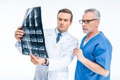 Doctors examining x-ray image Stock Photo