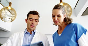 Doctors examining x-ray report. In hospital stock footage
