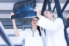 Doctors examining a x report. In hospital Stock Photography