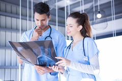 Doctors examining a x report. In hospital Stock Photo