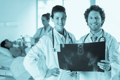 Doctors examining Xray Stock Image