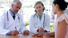 Doctors explaining something to patient Stock Photo