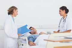 Doctors explaining the symptoms to a patient Royalty Free Stock Photo