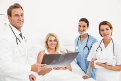 Doctors explaining x-ray to patient Stock Images