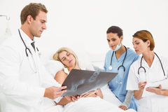 Doctors explaining x-ray to patient Stock Photos