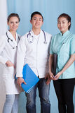 Doctors and female assistant before work Stock Photo