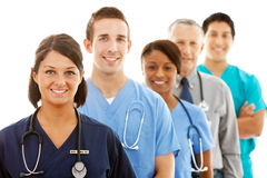 Doctors: Female Nurse Heads Line of Medical Professionals royalty free stock image