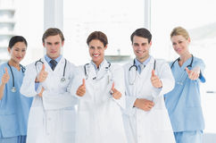 Doctors gesturing thumbs up at hospital Royalty Free Stock Images