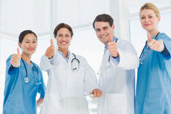 Doctors gesturing thumbs up at hospital Royalty Free Stock Photography