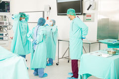 Doctors gettting dressed for surgery royalty free stock image