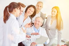 Doctors group at clinic with staff. Doctors group at clinic with administration staff work in cooperation Royalty Free Stock Images