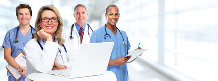 Doctors group. Group of medical doctor over health care clinic background Stock Images