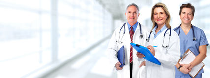 Doctors group. Group of medical doctor over health care clinic background Royalty Free Stock Photos