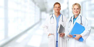 Doctors group. Group of medical doctors over blue clinic background Stock Photos