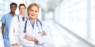 Doctors group. Group of medical doctors over blue clinic background stock photo