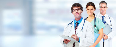 Doctors group. Group of medical doctors over blue clinic background Stock Image