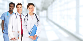 Doctors group. Group of medical doctors over blue clinic background Stock Images