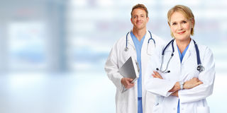 Doctors group. Group of medical doctors over blue clinic background Royalty Free Stock Photography