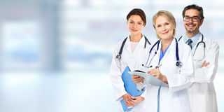 Doctors group. Group of medical doctors over blue clinic background Royalty Free Stock Images