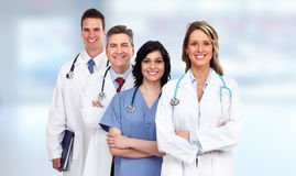 Doctors group. Group of medical doctors over blue hospital background royalty free stock photo