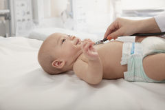 Doctors hand checking the heartbeat of a baby, close-up Royalty Free Stock Photos