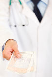 Doctors hand holding medical prescription. Closeup Stock Photo