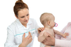 Doctors hand with syringe vaccinating child baby flu injection s Royalty Free Stock Photos