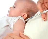 Doctors hand with syringe vaccinating child baby flu Stock Image