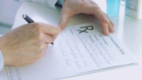Doctors hand writting rx prescription stock footage