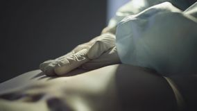 Doctors hands in white gloves making chest compression to a human body. Doctorshands in white gloves making chest compression to a young human body stock footage