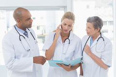 Free Doctors Having An Important Phone Call Stock Photos - 53850313