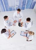 Doctors having conference meeting in hospital stock photos