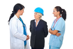 Doctors having conversation with architect Stock Photography