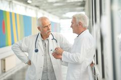 Doctors having a conversation. Work royalty free stock photo