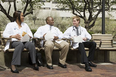 Doctors having lunch Royalty Free Stock Images