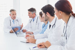 Doctors having a medical discussion stock photography
