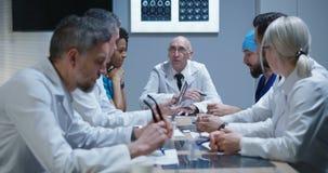 Doctors having a meeting. Medium shot of doctors talking during a meeting stock video footage