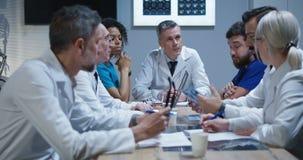 Doctors having a meeting. Medium shot of doctors talking during a meeting stock video