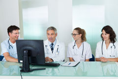 Doctors having a meeting stock images