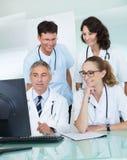 Doctors having a meeting stock photos