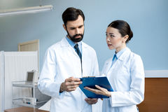 Doctors holding diagnosis Royalty Free Stock Images